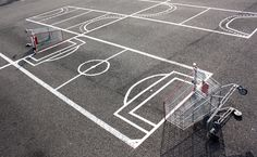 'urban hactivist' florian rivière goes about city streets creating humorous and interactive public art interventions using mundane materials.  one of the french artist's latest projects is 'don't pay, play' where he has transformed a strasbourg parking lot into a playing field  for multiple sports including: basketball, football, hockey, tennis and waterpolo. each pitch / rink / court occupies a single parking space,  made over by simply using tape and shopping carts.