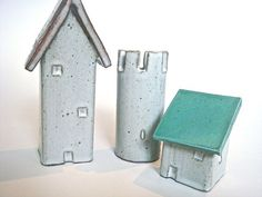 So adorable!  Little Ceramic Houses Group 5 by ClayTownCeramics on Etsy, $43.50