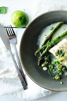 Baked cod in coconut sauce with wasabi & asparagus