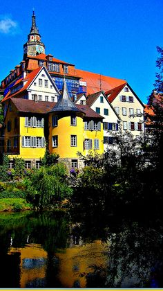 Tübingen, Hölderlin Tower & City  with  reflexions on the river Neckar in Tübingen, Germany