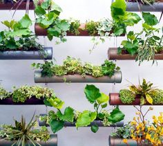 This modular planters are pretty cool, they could easily be made using recycled PVC Pipes that were painted.