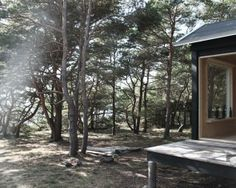 Wooden cabin in Sweden by Septembre Architecture containing a sauna and a bedroom with large picture windows that frame views of the surrounding forest. Picture Rail Molding, Architecture Parisienne, Timber Architecture, Building Architecture, Building Design, Wooden Facade, Tiny House Exterior, Journal Du Design, Farmhouse Dining Chairs