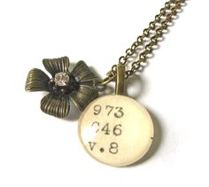 sweet... library catalog card jewelry.  LOVE