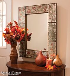 Allow your entryway to make a statement with a large mirror and seasonal décor. You don't need to go over-the-top; Just add a few fall-themed pieces here and there to get the point across.