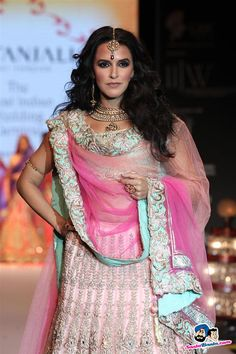 Bollywood diva Neha Dupia stopper wearing a beautiful bridal pendent, armlet, tikka and statement ring in India International Jewellery Fahion Week 2013