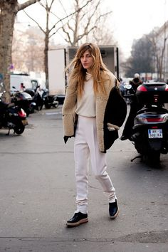 shearling coat matching shoe tones and all-white clothing