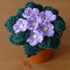 African Violets Free Crochet Pattern This is fantastic! I can't believe these are crochet. Crochet Home, Love Crochet, Crochet Motif, Knit Crochet, Knitted Flowers, Crochet Flower Patterns, Crochet Cactus, Crochet Gratis, Crochet Accessories