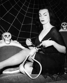 Vampira    I wish I could be loved and idolized for being dark and creepy. :)