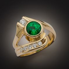 Glenn Dizon Designs.  One of a kind tsavorite and diamond ring.  Tsavorite is a rare form of garnet.  This 1.49 carat stunner is one of the nicer tsavorites I have had the pleasure to work with.  Just finished and available for sale.