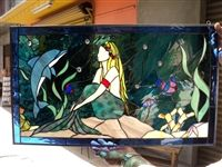 Mermaid with dolphin in stain glass