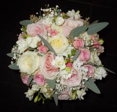 Handtied bouquet of roses, spray roses, gypsophila and freesia