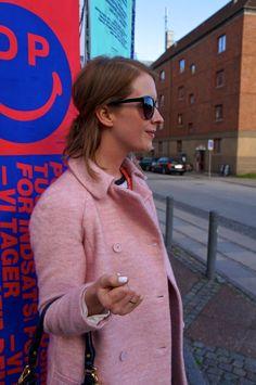Cat eye sunglasses and pink coat