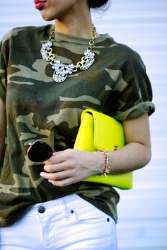 Give camo a makeover by updating your look with white jeans, geometric jewelry, and a burst of neon.