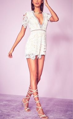 How adorable is this lace romper from Missguided?Cut-out lace adds beautiful texture along with sheer ladder-stitched detailing at the plunging neck.
