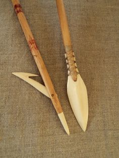 "Bone harpoon experiment as well a ""Rhombus"" arrowhead."