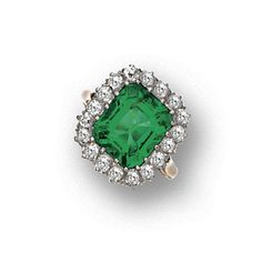 EMERALD AND DIAMOND RING, CIRCA 1900.  The emerald-cut emerald weighing approximately 4.20 carats, framed by 18 old-mine diamonds, mounted in gold and platinum,