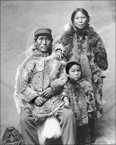 Inuit Family dressed in Winter clothing, Alaska -- (Date:  1903).