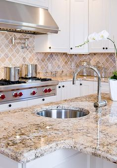 white granite...love the tile backsplashes too