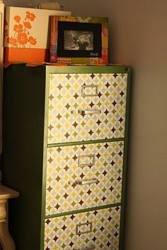 Repurpose an old filing cabinet with vinyl. Spray paint file cabinet and vinyl front file draws.