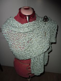 handknitted shawl with Celtic pin