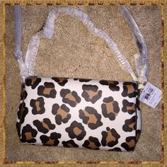 COACH CROSS-BODY IN OCELOT Cute COACH cross body bag in Ocelot with two different straps to carry.  Use the long leather one for a cross body look, and the shorter gold twisted chain to carry on your wrist or in your hand.  Both straps clip on and off.  Turn lock close on the front; lots of room inside.  NWT. Coach Bags Crossbody Bags