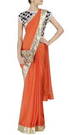 Surendri by Yogesh Chaudhary - - Orange flat chiffon satin sari with gotta detail. It comes with a flat knitted rayon pacman blouse. Elegant Dresses Classy, Elegant Saree, Classy Dress, Indian Attire, Indian Outfits, Indian Clothes, India Fashion, Asian Fashion, Women's Fashion