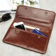 Losing your passport or important documents on your travels can feel like the end of the world. Invest in the Torrino leather travel wallet!  COMES WITH AN INDUSTRY LEADING 25 YEAR WARRANTY  The perfect travel companion, this leather document wallet is spacious enough to hold boarding cards, passports, currency and plane tickets with ease, allowing you to travel in style. Lined in soft yet hardwearing wipe-clean faux boar fabric and handcrafted with robust Italian leather, this elegant and…