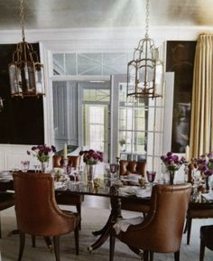 Dining room: lacquered dark brown walls w/gold vine painted on & brushed metallic silver painted ceiling