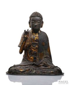 A rare and unusual lacquered bronze seated figure of Buddha,Southern China or Vietnam, 14th - 15th Century. Photo Nagel Auktionen