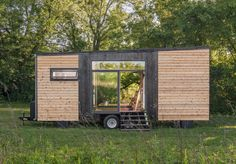 Tiny homes have taken the world by storm, and we're fascinated with their ability to make a minimal amount of square footage feel like an open and airy living space. The Alpha Tiny Home designed by New Frontier Tiny Homes showcases just how many features can be integrated into a trailer-style abode that can go anywhere. New Frontier packed a lot luxury into 240 square feet. Set on wheels, the exterior boasts large glass windows with shou sugi ban cedar siding and a mechanical seam metal…