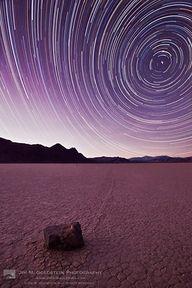 Beautiful star trails in a purple sky.