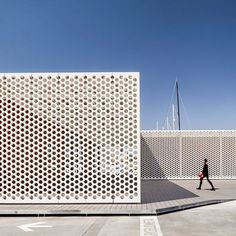 SCOB Architecture and Landscape has built a restaurant and an office block in Barcelona's Port Vell Marina, and covered both buildings with perforated white screens. #architecture #barcelona