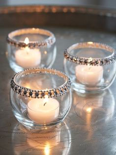 This is a simple way to spice up an everyday votive. You can buy rhinestones from Michael's or AC Moore, glue them with a hot glue gun or gorilla glue and voila! A perfectly beautiful tealight