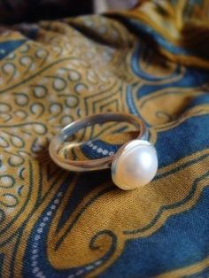 Just a simple pearl ring for an engagement ring is perfect by mee