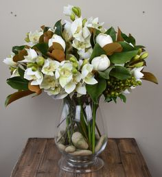 Cymbidium Orchids and Magnolias. An elegant mixture of Cymbidium Orchids, Magnolia Foliage, Magnolia buds and green berries. Stunning! http://www.countryaccentfloralboutique.com/ #artificialflowers #homedecor #decor #arrangement #weddingdecor #silkflowers #eventdecor #CountryAccent #floral #boutique #Australia | Country Accent