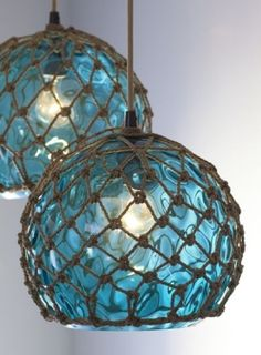 Coastal netted blue glass float fishing buoy lighting