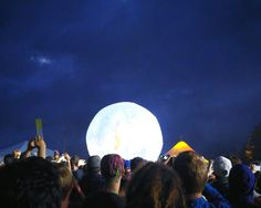 Crowd Enjoying At Music Concert Against Moon In Sky At Night