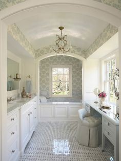 Marble #bathroom with #mint #wallpaper and #white cabinetry.  Absolutely gorgeous!