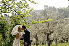 Sharing a kiss during their wedding in Italy at the Castello di Vincigliata. Photos by  Edoardo Agresti. @TuscaniaEvents