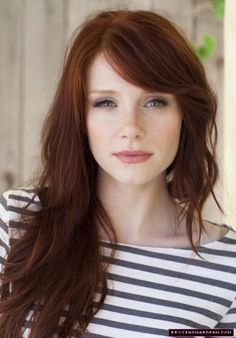 Pretty hair, wonderful pale skin, and fine freckles. This is a very pretty Lady.
