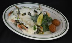Shrimp Florentine. Stuffed with spinach, three cheeses, light cream sauce