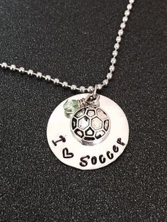 A personal favorite from my Etsy shop https://www.etsy.com/listing/211535154/hand-stamped-soccer-necklace-soccer