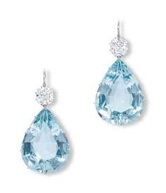 AQUAMARINE AND DIAMOND EAR PENDANTS each suspending a pear-shaped aquamarine, to the old-mine and cushion-shaped diamond surmount weighing 3.10 and 3.06 carats, mounted in platinum, 5.3 cm long