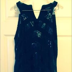 White House Black Market black sequined blouse L White House Black Market sequined black sleeveless blouse size large.  Perfect to wear with jeans or dress up with a pencil skirt and heels. White House Black Market Tops Blouses