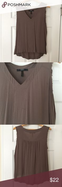 BCBG Paris Flowy Top Good condition. Two small spots on front (pictured). Raw edge hems. Flowy fit. Longer in back. Color is a dark taupe. BCBG Paris Tops Tank Tops