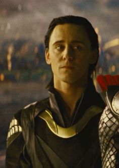 Young Loki standing in Thor's shadow