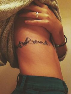 This side mountain tattoo may look treacherous but it's absolutely stunning.