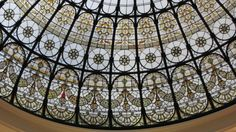 1901's stained glass dome - it was protected during World War 2 and only one pane broke, spot the red glass which marks it.