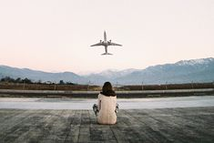 Sitting in the arms of the one u love talking and watching airplanes that's where I wanna be