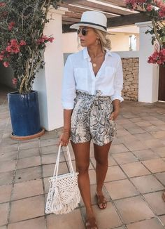 Spring style - summer style - snake print shorts - knit bag - havana hat # Casual Outfits shorts ideas Simply by Simone - Fashion and inspiration for a stylish lifestyle. Based in Westchester County and New York City.